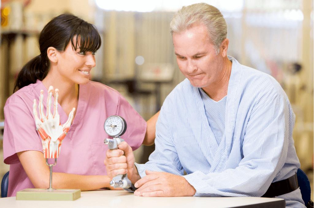 Man testing grip strength with smiling nurse